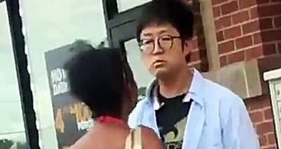 アジア人男性が黒人女性を殴る.jpg