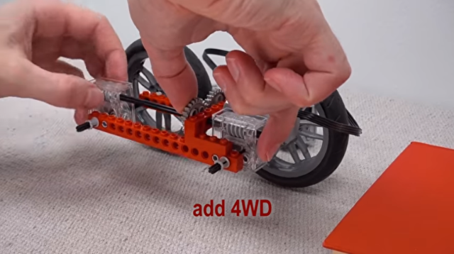 レゴカーが困難な障害を越えるよう進化する過程.png